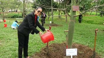 Elle Fersan watering the Zouk Mikael tree at the Guangzhou International Award for Urban Development tree planting ceremony